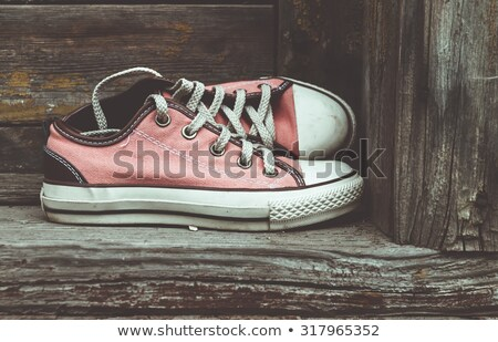 öreg elnyűtt sportcipők utca retro sport Stock fotó © stevanovicigor