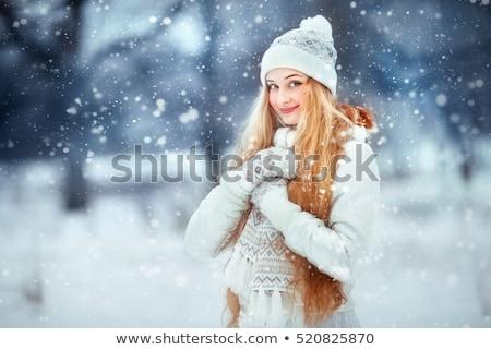 Fiatal nő tél ruházat áll hó néz Stock fotó © dariazu