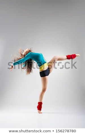Modern style dancer posing on grey background Stock photo © julenochek