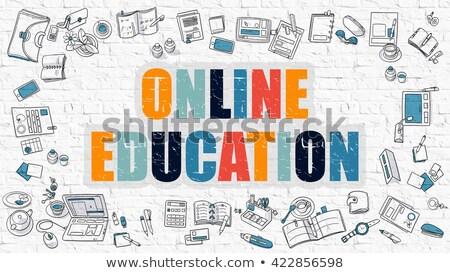 Online Courses Concept. Multicolor on White Brickwall. Stock photo © tashatuvango