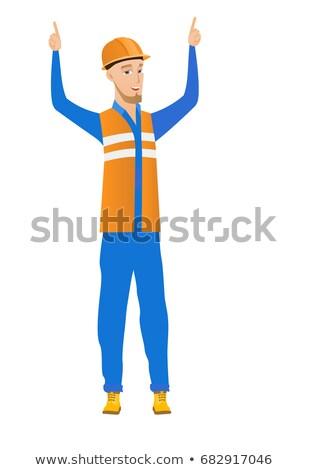 Caucasian builder standing with raised arms up. Stock photo © RAStudio