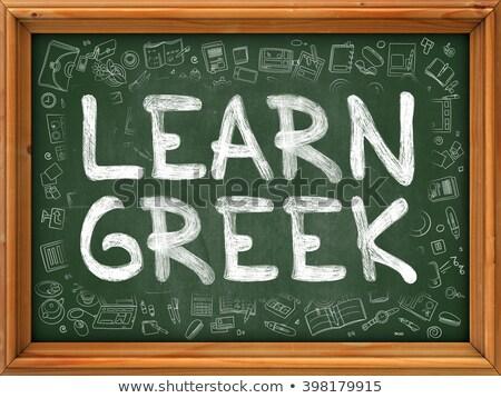 Green Chalkboard with Hand Drawn Learn Greek. Stock photo © tashatuvango