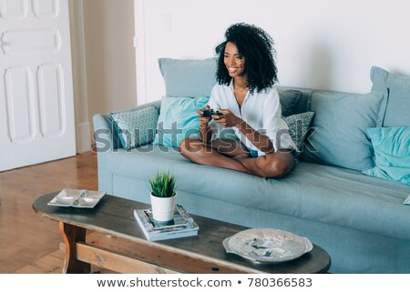 Girl playing video games, looking up Stock photo © IS2