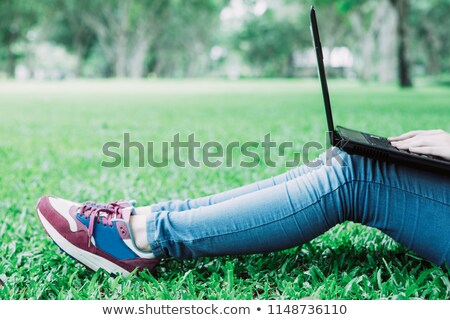 Cropped side view of schoolgirl sitting outdoors Stock photo © deandrobot