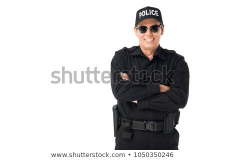 Policjant stałego fałdowy broni uśmiechnięty Zdjęcia stock © RAStudio