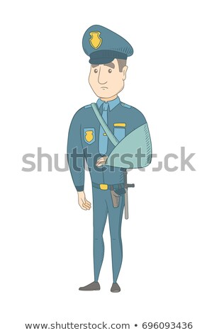 Injured young caucasian policeman with broken arm. Stock photo © RAStudio