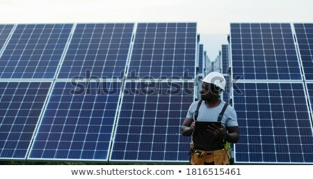 Young african-american worker of solar power plant Stock photo © RAStudio