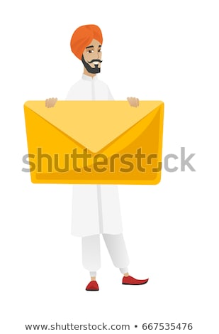 Hindu businessman holding a big envelope. Stock photo © RAStudio