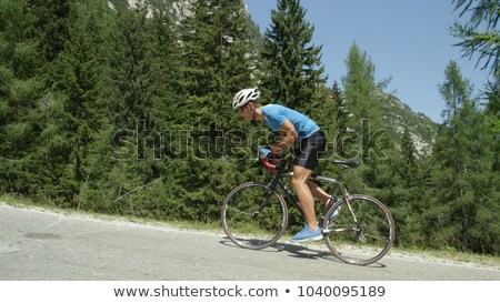 cyclist riding bicycle on the road stock photo © stevanovicigor