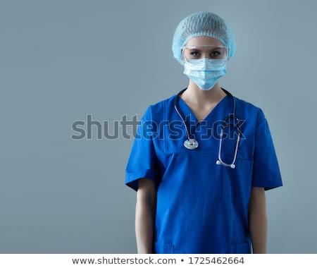 portré · mosolyog · női · orvos · áll · akta - stock fotó © is2