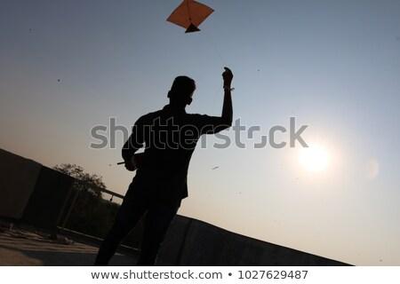 Adam uçan uçurtma mavi gökyüzü Avrupa gülen Stok fotoğraf © IS2