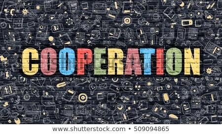 Business cooperazione doodle design buio Foto d'archivio © tashatuvango