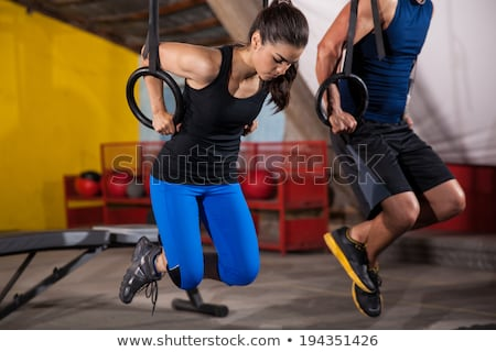 two guys on pull up rings stock photo © is2