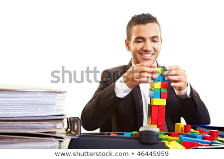 business man playing with blocks stock photo © is2