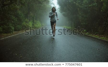 Stock photo: Handsome jogger running in the exotic area