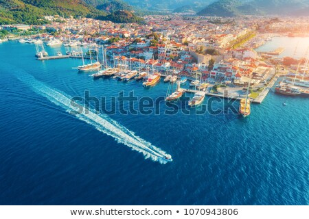 aerial view of boats and yahts and beautiful architecture at sunset stock photo © denbelitsky