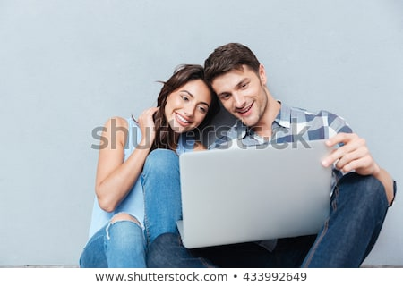 portrait of happy couple with laptop stock photo © wavebreak_media