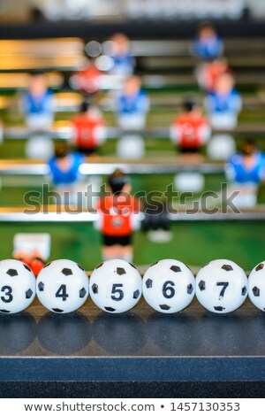 Five yellow and blue balls on the soccer's field Stock photo © stefanoventuri