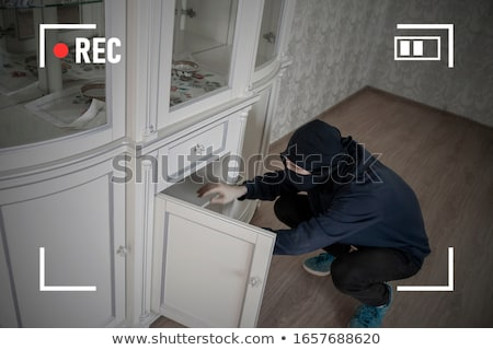 robber searching house for valuables stock photo © andreypopov