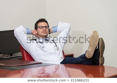 Genç doktor oturma ofis adam öğrenci Stok fotoğraf © Jasminko