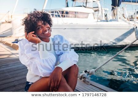 женщину сидят док улыбающаяся женщина улыбаясь портрет Сток-фото © IS2