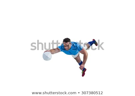 Rugby player mid air with ball Stock photo © IS2