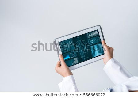 doctor hands with tablet pc at clinic Stock photo © dolgachov