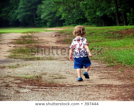 Girl skipping on the dirt road Stock photo © bluering