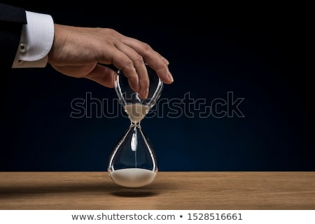 businessman with hourglass Stock photo © get4net
