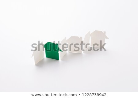 a paper cutout row of houses green background Stock photo © magann