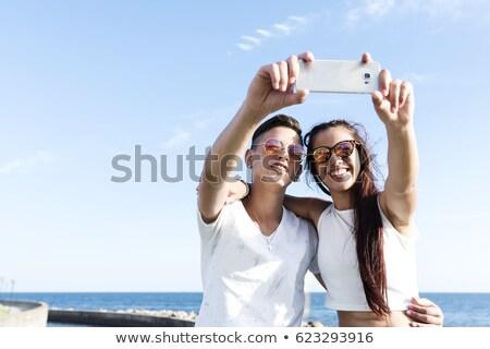 çift plaj cep telefonu kum kadın Stok fotoğraf © IS2