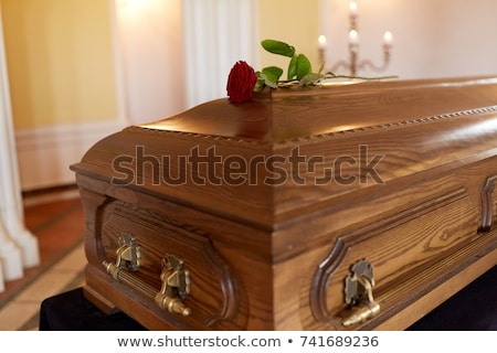 red rose flower on wooden coffin in church Stock photo © dolgachov