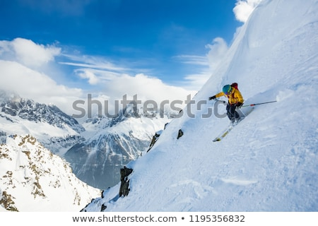 Man skiing down slope Stock photo © IS2