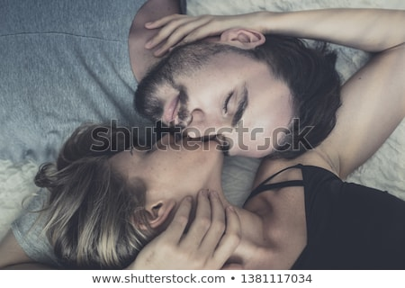 Man kisses woman on cheek Stock photo © IS2