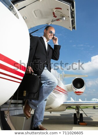 Casual businessman exiting private plane Stock photo © IS2