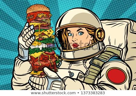 Hungry woman astronaut with Burger Stock photo © studiostoks