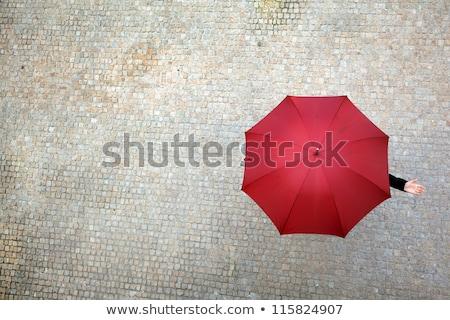 Oculto paraguas pie azul mujer Foto stock © CsDeli