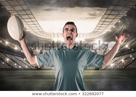 Composite image of a rugby player gesturing victory Stock photo © wavebreak_media