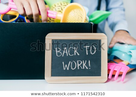 man storing summer stuff and text back to work Stock photo © nito