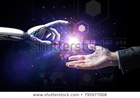 robot and human hand over virtual projection stock photo © dolgachov