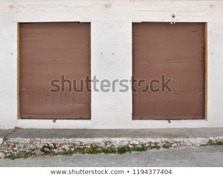 Old store roller doors in rural Greece Stock photo © simazoran