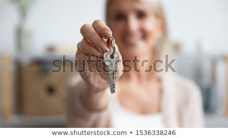 Femminile agente immobiliare tasti senior adulto Foto d'archivio © feverpitch