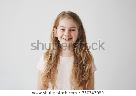 Portrait of a satisfied young girl in dress Stock photo © deandrobot