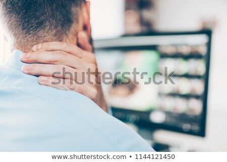 Office worker with neck pain from sitting at desk all day Stock photo © tommyandone