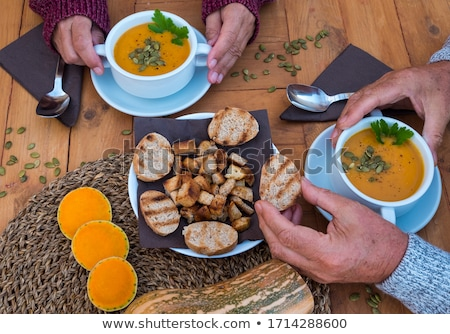 couple of bowls of homemade pumpkin soup stock photo © mpessaris
