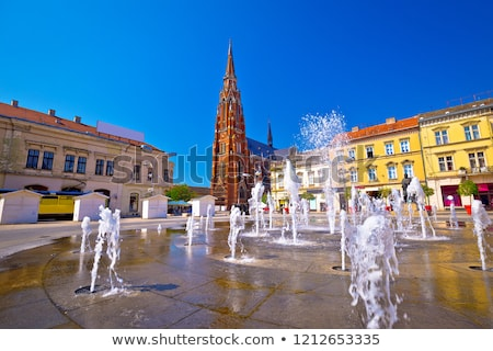 Osijek main square fountain and cathedral view Stock photo © xbrchx