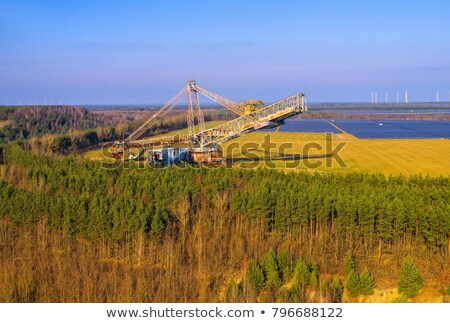 Graafmachine hemel aarde industrie energie Stockfoto © LianeM