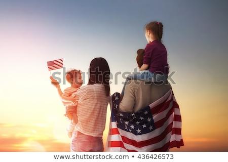 szczęśliwy · patriotyczny · kobieta · banderą · patrząc - zdjęcia stock © dolgachov