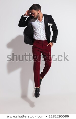 relaxed casual man holding sunglasses on forehead looks to side stock photo © feedough