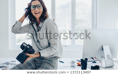 Photographer with Professional Camera and Photos Stock photo © robuart